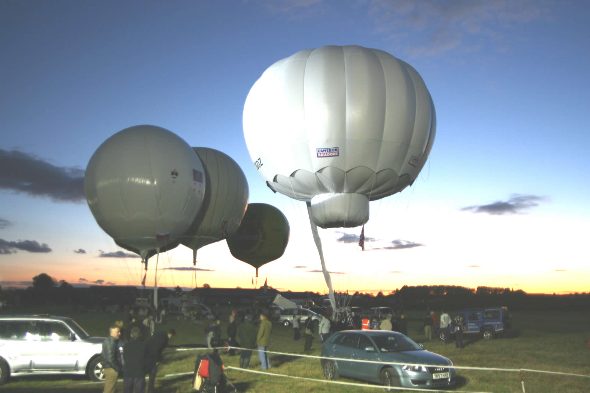 Inflated balloons at susnset as most race competitors are ready to go