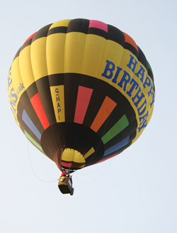 Happy Birthday Balloon flying over English Channel
