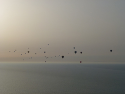 A morning sky full of hot air balloons