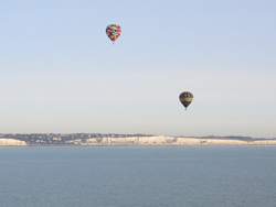 Multiple Hot Air Balloons flying over English Channel