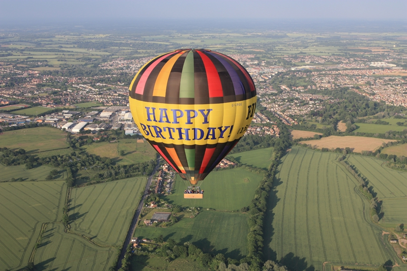 Our Happy Birthday Hot Air Balloon makes one of its flights over Essex with Braintree in the background