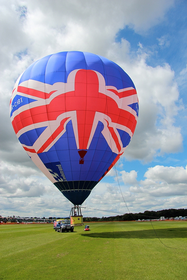 Our new Union Jack Hot Air Balloon is a Lindstrand with a volume of just 77,000 cubic feet, less than a fifth of the size of our biggest balloons and carries just two passengers and pilot. It is available for exclusive flights for two, film and location work, television etc. Prices start from £600, so to fly in our Union Jack hot air balloon call us on 01252 844222 for more details. We are really looking forward to flying this fabulous balloon very soon.