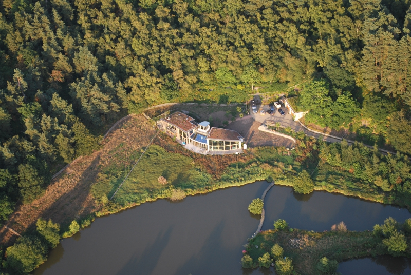 A recently built eco house near Frensham spied by our passengers on the flight.