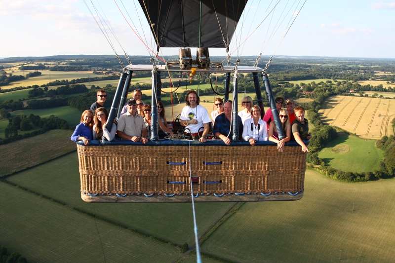 Joy and family and friends in the hot air balloon basket on a lovely July summer evening