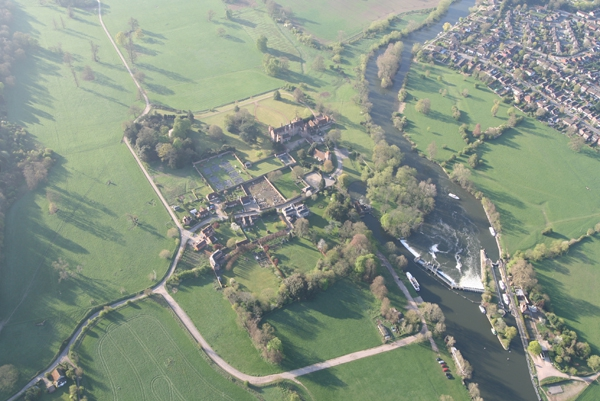 An aerial view of much of the main house and associated cottages and buildings of Mapledurham, a short distance down the River Thames from Hardwick House. This picture also shows the weir and the mill at Mapledurham.