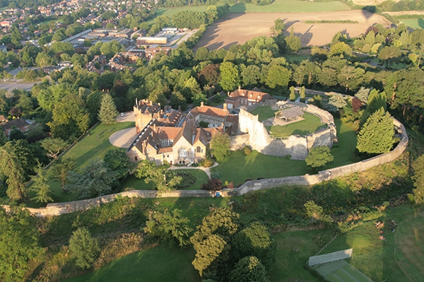 Dawn sunlight bathes Farnham Castle as we take off from Farnham Park in Surrey and get this great aerial view