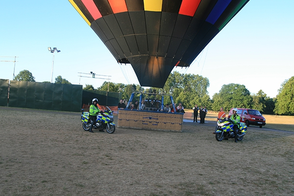 Just before take off two police motorcyclists turned up and having established they weren't booking us for speeding we got them to pose in front of our basket with their colourful bikes.