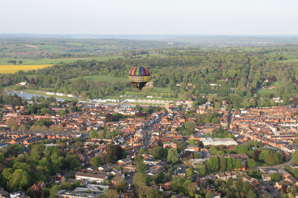 Preparations are underway for the 2014 Henley Regatta as one of our hot air balloons flies past on a spring evening
