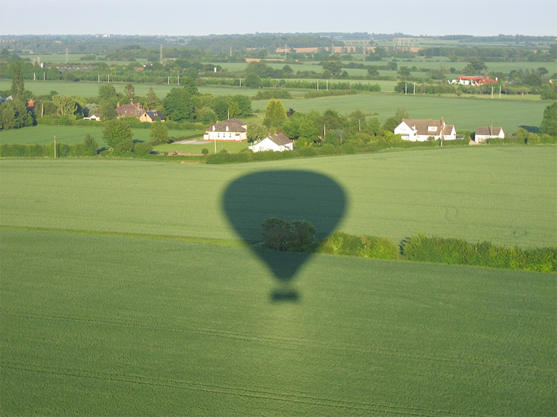 Taking pictures of the balloon shadow and the aerial view is popular on Sussex Balloon Flights and Rides
