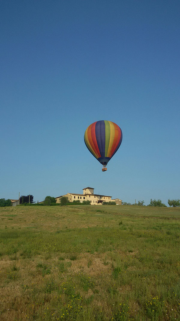 "Our ""Rainbow"" balloon comes in to land on its first flight in Italy near Tavarnelle Val Di Pesa, 20 miles south of Florence."