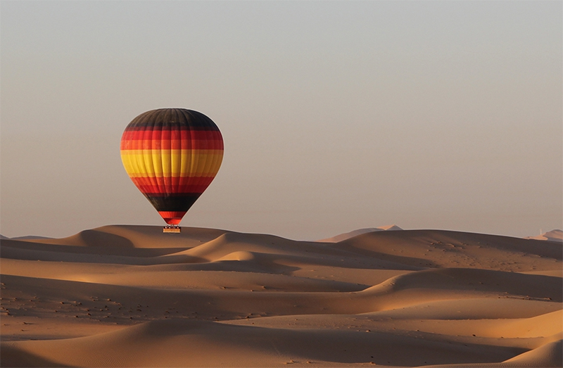 Get a glimpse of the bird's eye view from the hot air balloon basket into the heart of the desert with its uninterrupted desert vistas and rolling red dunes. Rising early for a sunrise flight and watch the sun creep over the horizon creating spectacular visual images over the dunes below. Spot wandering camels, gazelles or oryx that roam the conservation area, maybe meet up with falconers or farmers as you land for great photographic memories. Enjoy some cold refreshments after touch down as your balloon pilot presents you with your flight certificate and then head back into Dubai where you will be dropped off to enjoy the rest of your day.