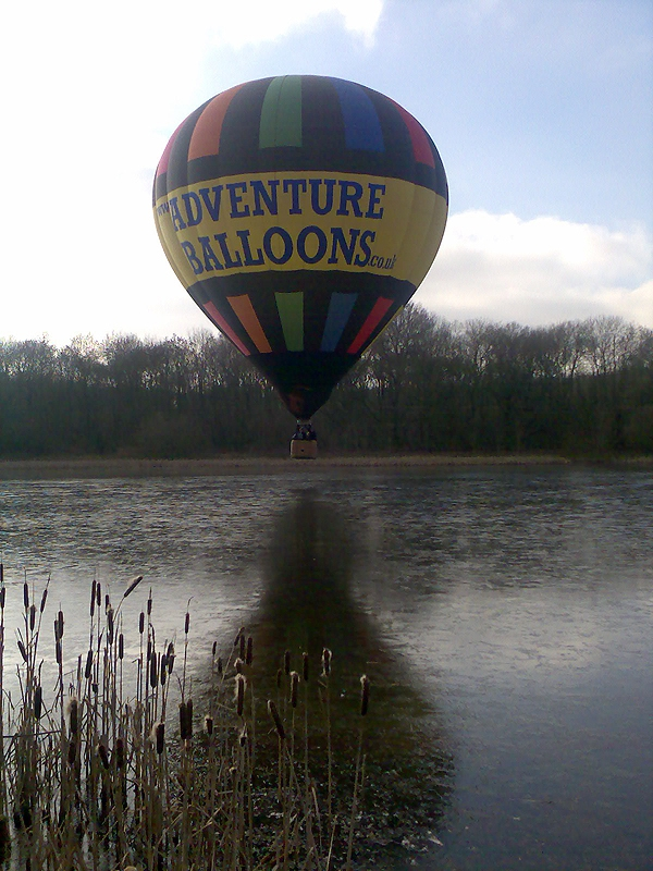 The classic picture of a hot air balloon reflection over water, shame about the ice