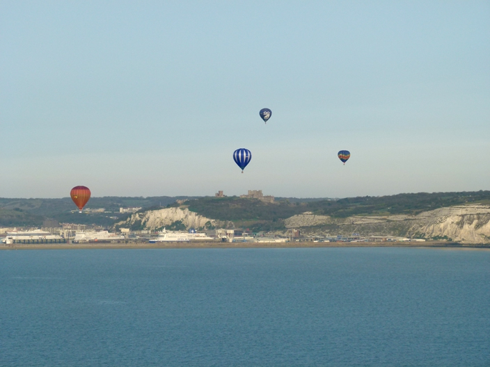 Hot air balloons flying over Dover Castle and the English Channel