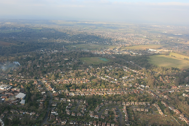Looking back towards Godalming from the South East on the balloon flight over Surrey. The Wey Navigation runs along the edge of the green fields in the picture.