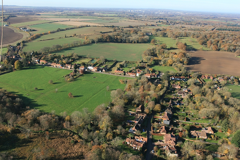 Greywell village in Hampshire view from the air with a picture taken by hot air balloon on a flight with Adventure Balloons.
