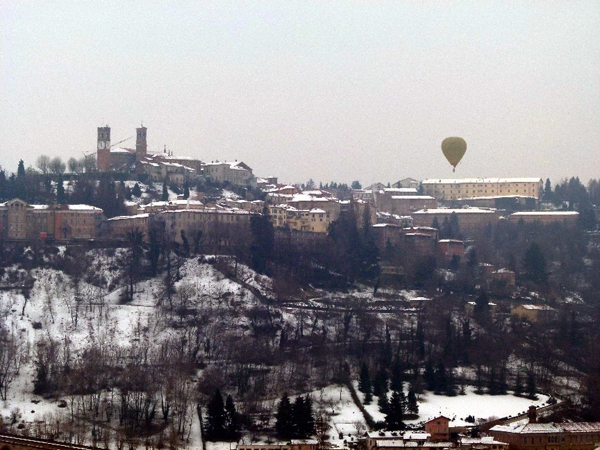 Hot air balloon flying over Mondovi old town