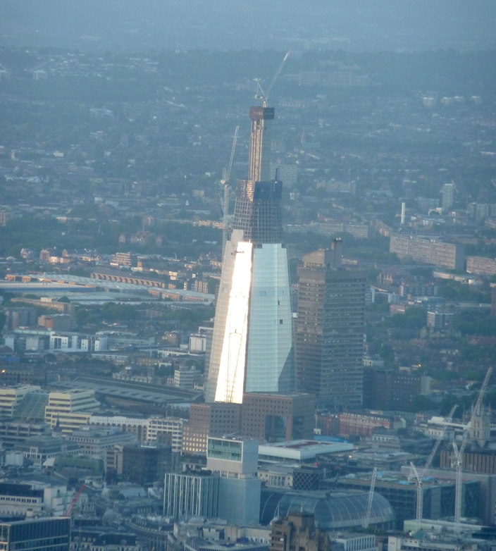 Flying past the Shard over the river Thames, London