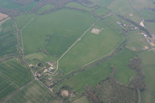 Ballooning over Berkshire and the Roman town of Calleva at Silchester from our balloon showing the amphitheatre at the bottom and the square excavation site towards the top of the picture
