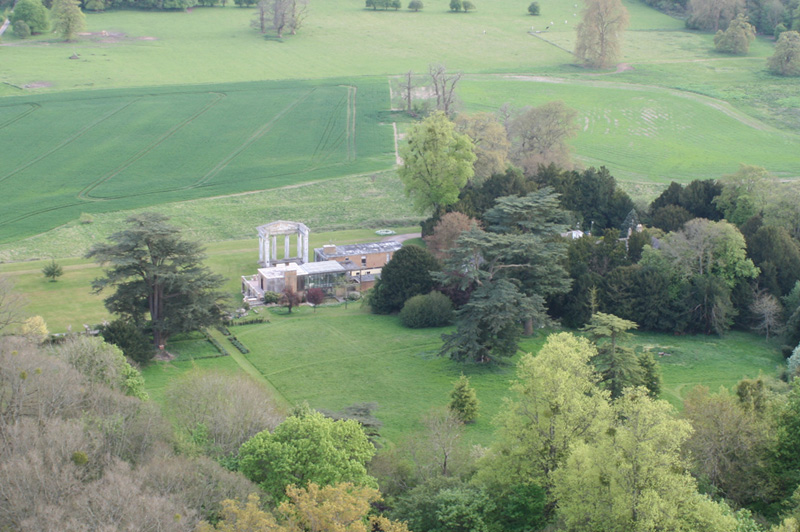 In these aerial photographs of Stratton Park, East Stratton Hampshire you can see the doric columned portico and stuccoed main block. This is the last remaining part of the original house designed by George Dance the younger and built in 1803. The grounds laid out at the same time contain a mixture of fine specimen trees which remain to the present day. In 1963 the original house was demolished by the owner John Baring and a modernist house by Stephen Gardiner and Christopher Knight was built but with no logical relationship to the portico. This is a regular site when our balloons fly from Micheldever on a westerly wind. Go to https://en.wikipedia.org/wiki/Stratton_Park for more information and history.