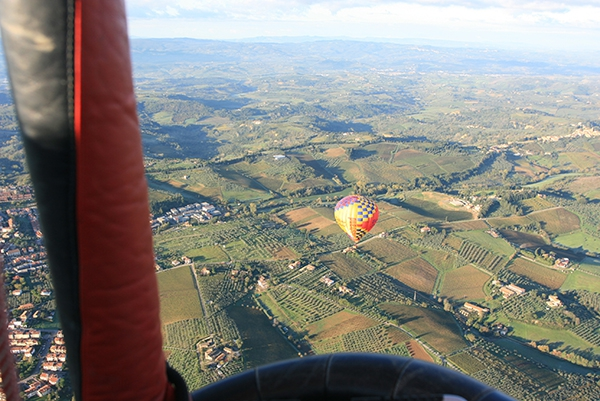 What a beautiful morning to be flying over the Tuscan countryside in Italy in a hot air balloon.