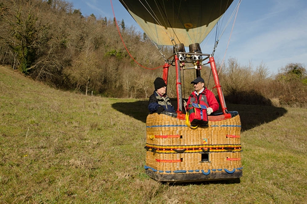 Tom and Kim wait in the balloon while Cate walks off to find the landowner