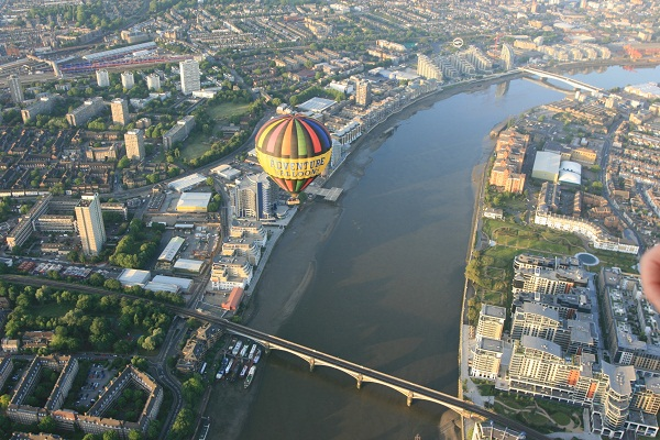 Balloon Flying over Wandsworth Bridge near London Heliport and aerial ...: https://www.adventureballoons.co.uk/picture/london/wandsworth-bridge