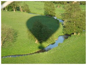 Our Lindstrand 330 hot air balloon casts a shadow over the river Wey