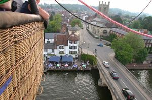 Drifting in a hot air balloon over the River Thames at Henley on Thames in Oxfordshire.